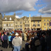 People watching units of The Sealed Knot marching through Stow Square