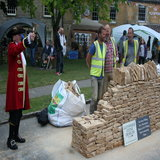 Town Crier announces the end of the dry-stone walling showcase demonstration