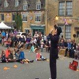 Fire-eating escapologist, John Hayns enthrals the crowd with his performance
