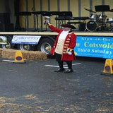 Town Crier, Ken Brightwell announces the arrival of the Mayor